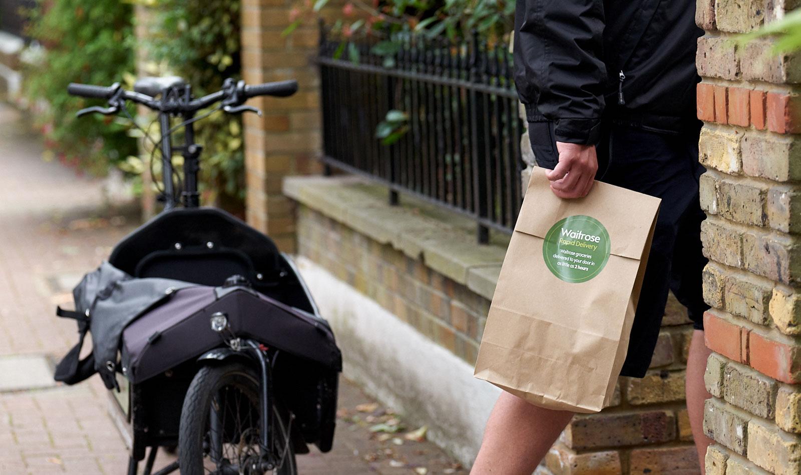 man delivering Waitrose bag of food